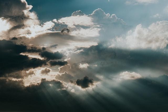 light piercing through clouds