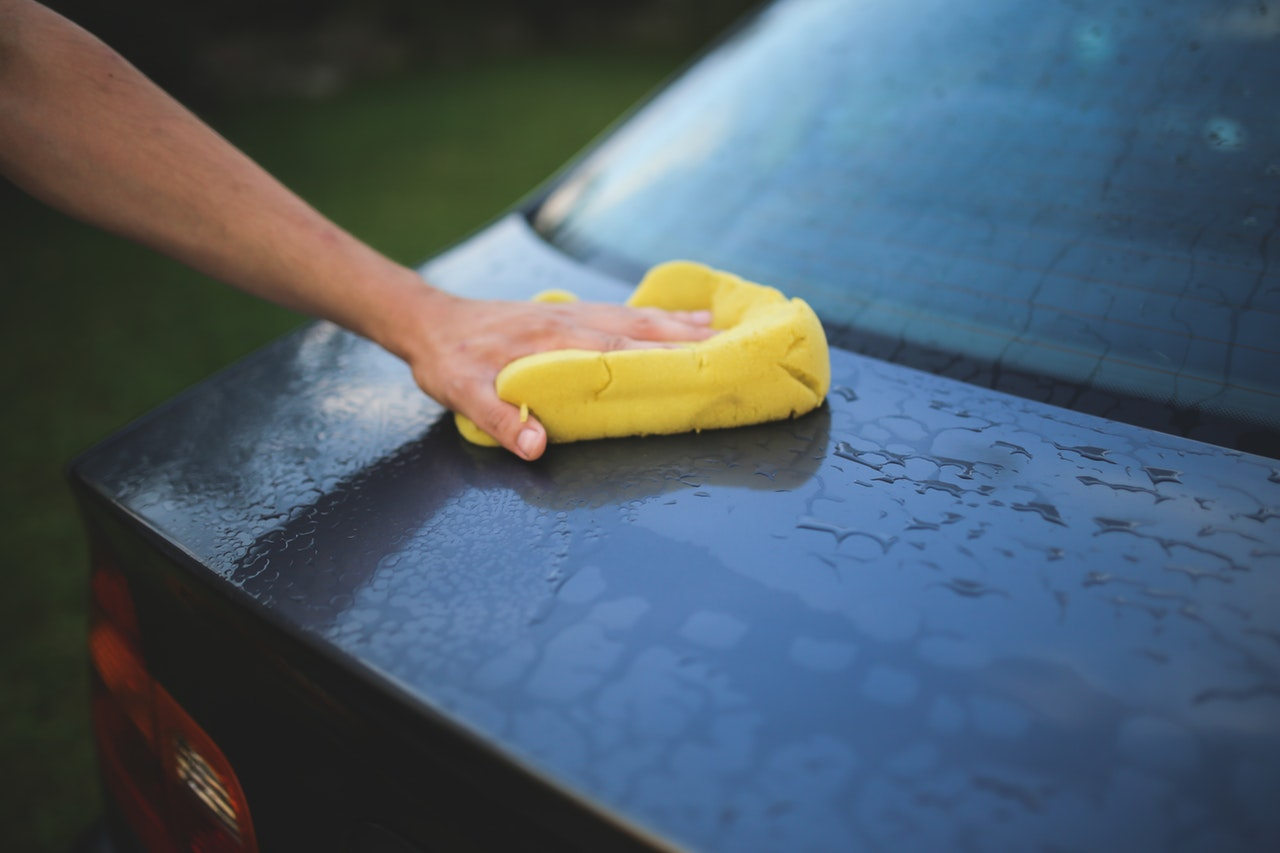 washing a car with a sponge