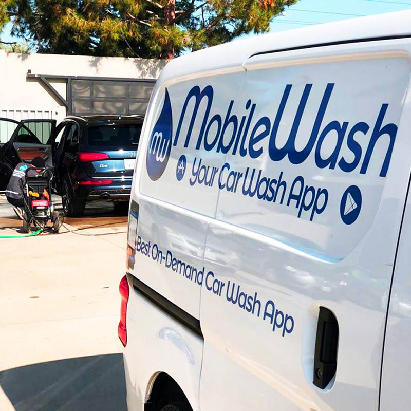 MobileWash washer doing a car cleaning on an Audi SUV for a mobile car detailing service.